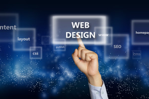 Business concept image of a businessman hand clicking Web Design button on virtual screen over space background